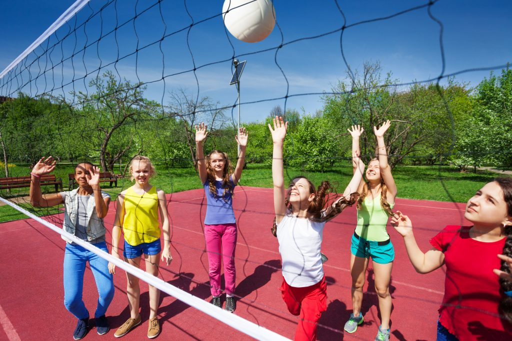 Kids playing volleyball outside